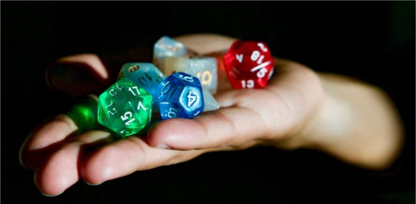 dice in hand by Alex Chambers