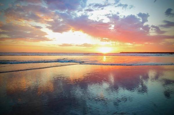 Sunset over Ocean by Sarah Chorn