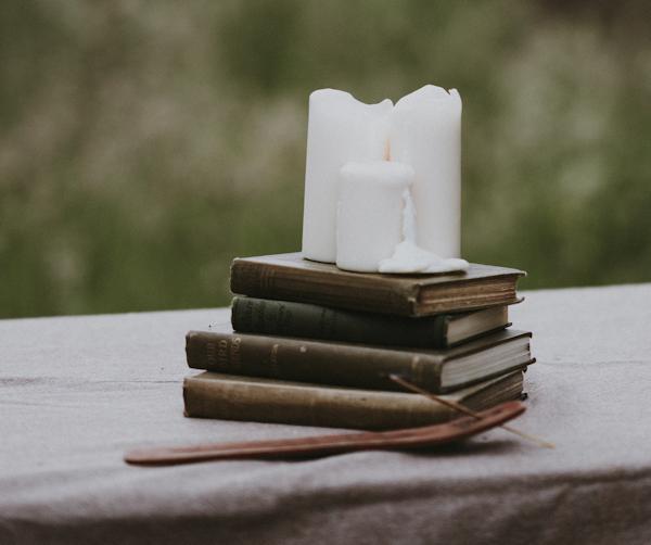 Candles on Books by Annie Spratt (detail)