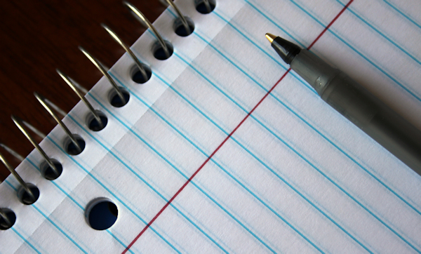 lined paper and pen by Mira Cosic